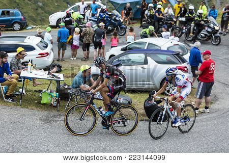 Col du Glandon, France - July 24, 2015: Two French cyclists (Warren Barguil of Giant-Alpecin and Thibaut Pinot of FDJ),climbing the road to Col du Glandon in Alps, during the stage 19 of Le Tour de France 2015.