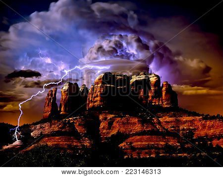 An HDR composite image of Sedona's Cathedral Rock taken under Moonlight merged with two separate storm photos taken on a separate night.