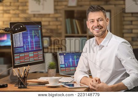 Young stock exchange trader working in office