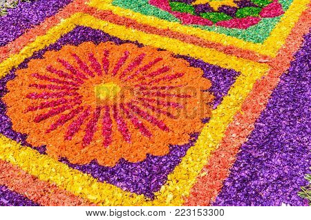 Antigua, Guatemala -  March 26, 2017: Dyed sawdust Lent procession carpet detail in town with most famous Holy Week celebrations in Latin America