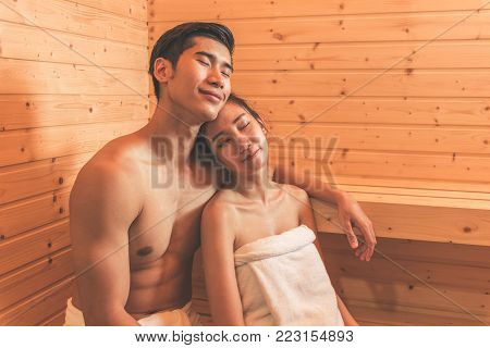 Young Asian Couples Or Lovers Have Romantic Relaxing In Sauna Room. Skin Care Heat Treatment And Bod
