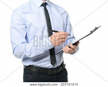 Car salesman writing on clipboard against white background
