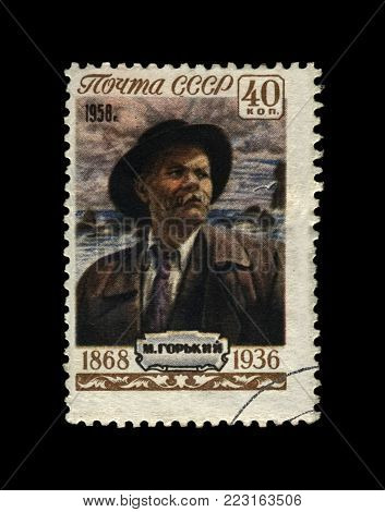 USSR - CIRCA 1958: canceled stamp printed in the USSR (Soviet Union) shows Maxim Gorky aka Alexei Maximovich Peshkov (1868-1936), famous Russian writer, dramatist, politician, circa 1958. vintage postal stamp isolated on black background.