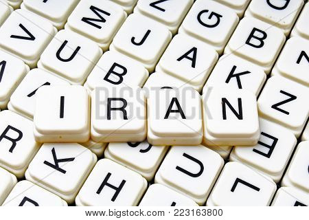 Iran text word crossword title caption label cover background. Alphabet letter toy blocks. White alphabetical letters. Iran.