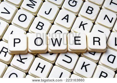 Power text word crossword title caption label cover background. Alphabet letter toy blocks. White alphabetical letters. Power.