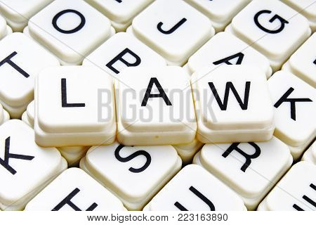 Law text word crossword title caption label cover background. Alphabet letter toy blocks. White alphabetical letters. Law.