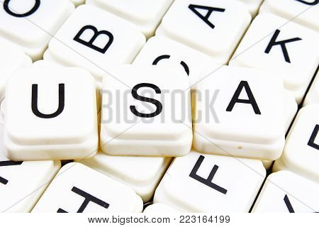 Usa text word crossword title caption label cover background. Alphabet letter toy blocks. White alphabetical letters. Usa.