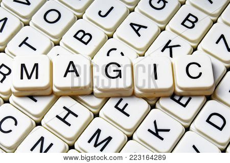 Magic text word crossword title caption label cover background. Alphabet letter toy blocks. White alphabetical letters. Magic.