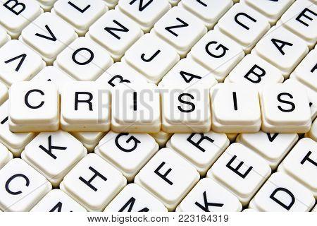 Crisis text word crossword title caption label cover background. Alphabet letter toy blocks. White alphabetical letters. Crisis.