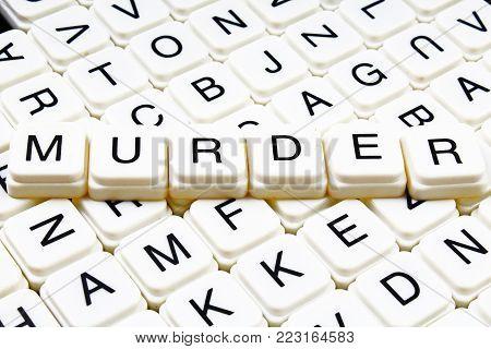 Murder text word crossword title caption label cover background. Alphabet letter toy blocks. White alphabetical letters. Murder.