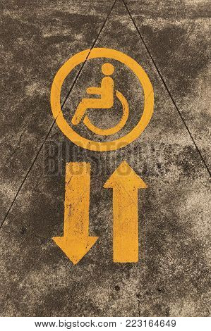 cripple sign on circle with arrow sign on the road