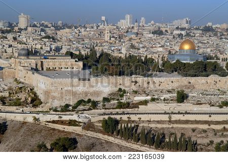 Old Jerusalem: view of the Temple Mount, numerous stone buildings, the Wailing Wall and the Muslim sanctuary A dome of the 7th century cliff with a golden dome, Israel.