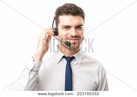 Customer support tech wearing a headset and talking to a customer against a white background