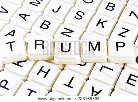 Trump text word crossword title caption label cover background. Alphabet letter toy blocks. White alphabetical letters. Trump.