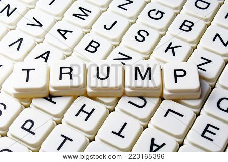 Trump text word crossword title caption label cover background. Alphabet letter toy blocks. White alphabetical letters. Trump