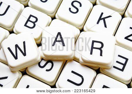 War text word crossword title caption label cover background. Alphabet letter toy blocks. White alphabetical letters. War.