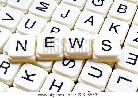 News text word crossword title caption label cover background. Alphabet letter toy blocks. White alphabetical letters. News.