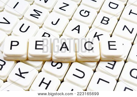 Peace text word crossword title caption label cover background. Alphabet letter toy blocks. White alphabetical letters. Peace.