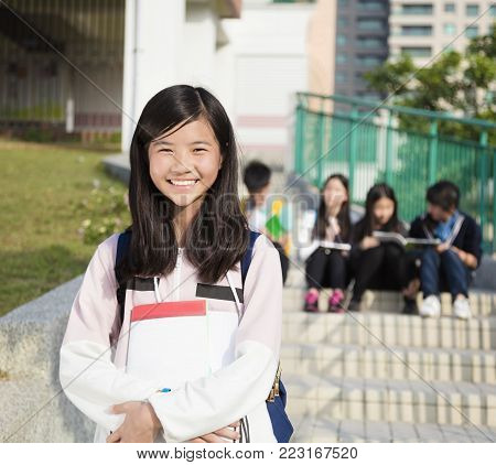 smiling asian girl Teenage Students standing  at campus