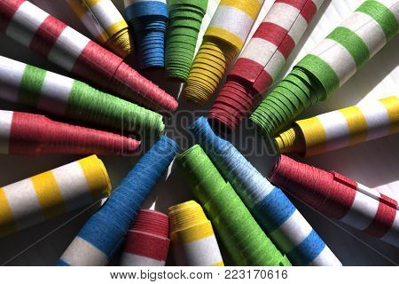 Colorful striped flings arranged in a circle and spoke design ready for a celebration
