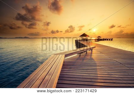 Wooded bridge in the port between on sunrise time at Rayong,Thailand