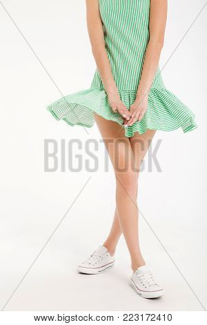 Half body portrait of a young girl in dress whirling isolated over white background