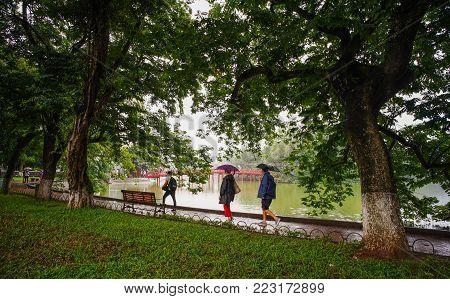 Hanoi, Vietnam - Sep 24, 2016. People Walking At Park Of Hoan Kiem Lake In Hanoi, Vietnam. From 1010