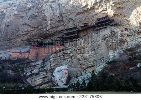 The famous hanging monastery near Datong, Shanxi province, China. The characters on the rock mean grand sight , the others are a buddhism poem