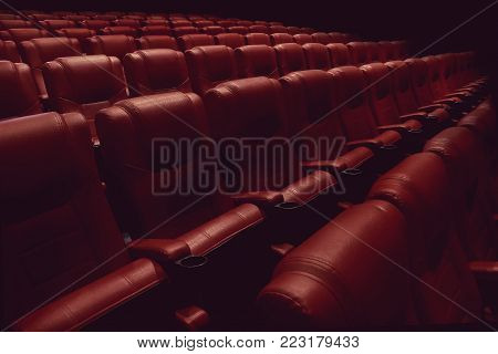 empty theater auditorium or movie cinema with red seats