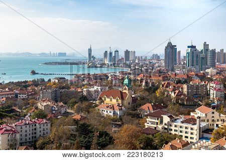 Qingdao Bay and the Lutheran church seen from the hill of Signal Park in Autumn, Qingdao, China