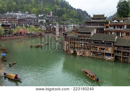 Old Houses on the river in Fenghuang Ancient town, Hunan province, China. This ancient town was added to the UNESCO World Heritage Tentative List in the Cultural category.