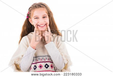 Lovely teen girl holding fingers on cheeks and looks at camera isolated on white background