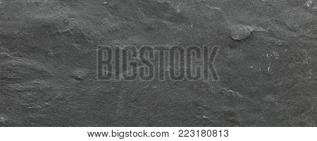 Dark grey ore black slate background or texture. Dark stone background, stone texture.