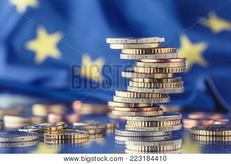 Euro Money.euro Flag.euro Currency.coins Stacked On Each Other In Different Positions. European Unio