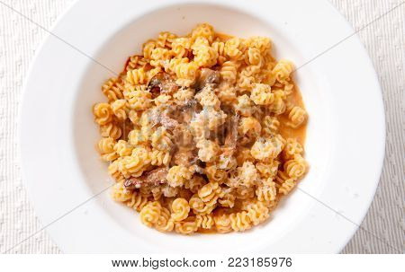 diced irish bacon with radiatore pasta and a heirloom tomato sauce stock photo