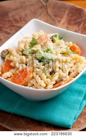 vegetarian gemelli pasta with farm fresh vegetables and parmesan cheese stock photo