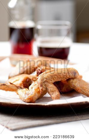 ethically raised chicken whole, uncut wings with a spicy sauce stock photo