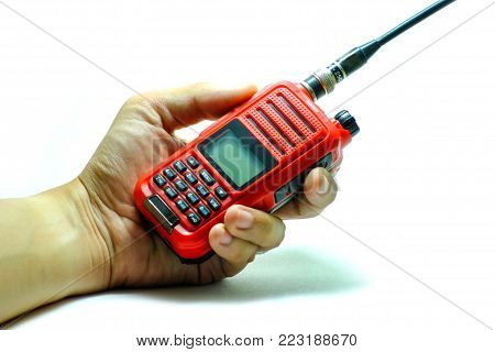 Portable radio transceiver in hand, isolated on white background