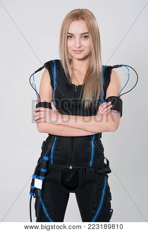 Beautiful Blonde In Electric Muscular Suit For Stimulation