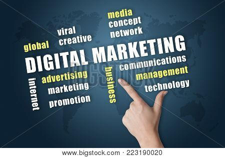 Digital Marketing wordlcloud on blue world map background with finger pointig on it.