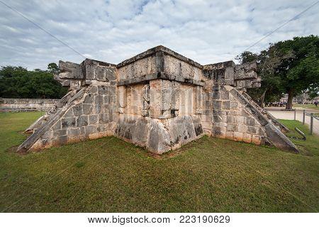 Chichen Itza snake head at Yucatan Mexico. Ancient temple