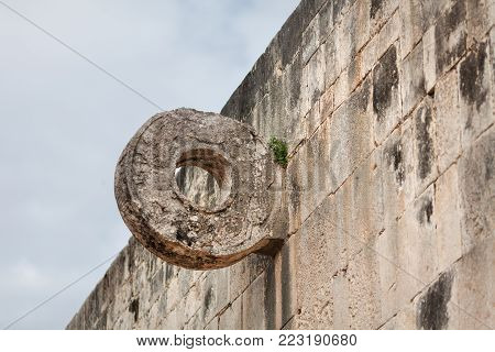 Stone ring at the great ball game court in the Mayan archeological site Chichen Itza, Mexico