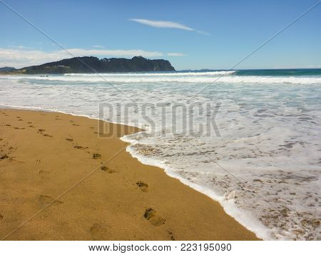 Hot Water Beach with footprints on the sand
