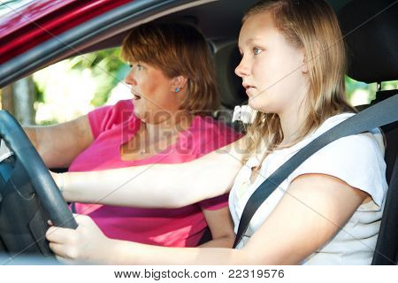 Teenage driver and her mother about to have a car accident.