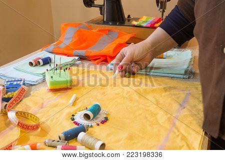 Close-up of woman's hand stitching quilting. Tailor Woman working in his tailor shop, Tailoring. Garment industry, tailoring concept