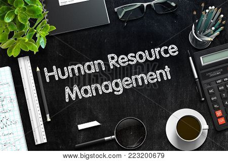 Human Resource Management Handwritten on Black Chalkboard. Top View of Black Office Desk with a Lot of Business and Office Supplies on It. 3d Rendering. Toned Image.