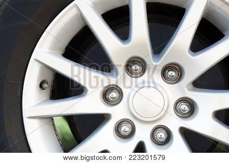 Alloy Wheel of Multi Purpose Vehicle family car.Close up of aluminium rim of luxury car wheel.