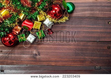 Old vintage Christmas decoration background arranged in opposing corners on rustic wood with copyspace