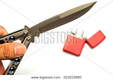 Butterfly knife (balisong) in female hand on a white background