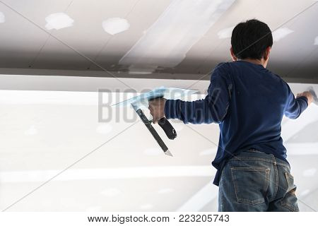 Man Professional Worker Cutting Tile